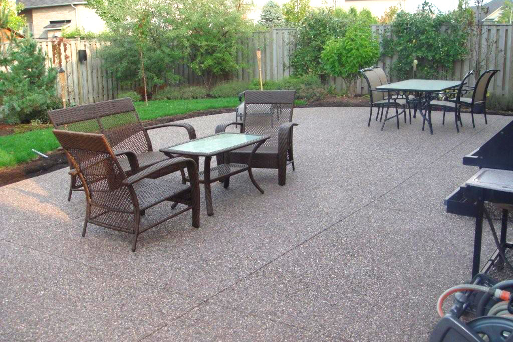 exposed pebble wash surfaces are a beautiful look for your walkways and patio