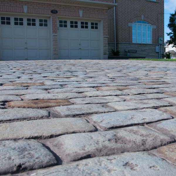 a rough paving stone look brings character to your driveway