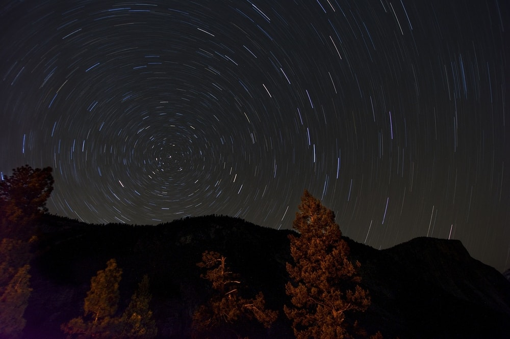 look up at the sky and enjoy the stars